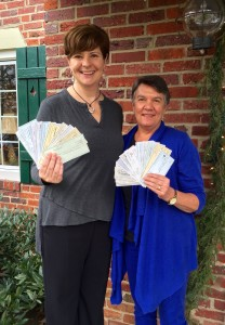 Adrienne Griffen, Founder and Executive Director of PSVa and Doris Parker, 100 Women Who Care member display this quarter's donation.